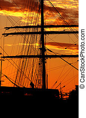 Harbor silhouette - Silhouette of a schooner against the...