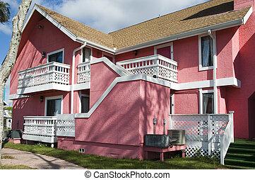 Pink Abandon Condo - Brightl pink Abandon condominium due to...