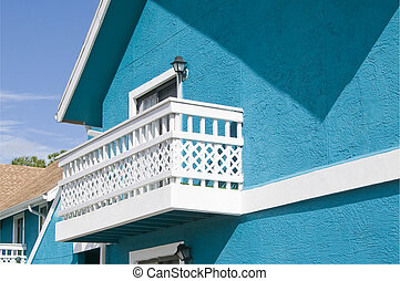 White Balcony - Brightl blue colored Abandon condominium...
