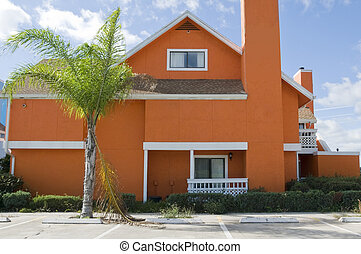 Orange Condo - Brightl Orange colored Abandon condominium...