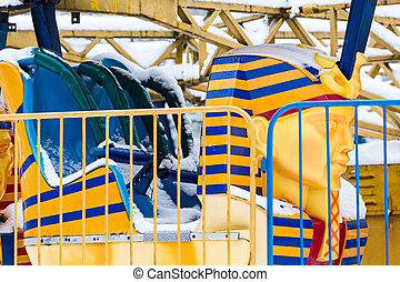 empty roller coaster cab under snow
