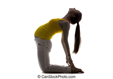 Prenatal Yoga, Camel Pose - Full length silhouette of young...