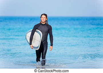 Ocean is my life - A young surfer with his board on the...