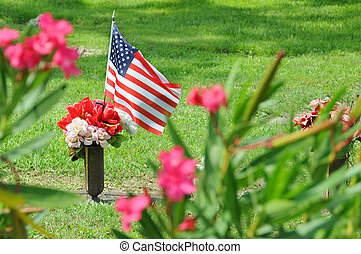 United States flag marking loss of military with flowers.