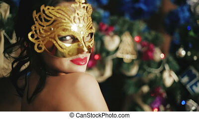 Beautiful sexy lady in the mask in the New Year's Eve