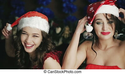 Two sexual girls in Christmas hats. a lot of fun