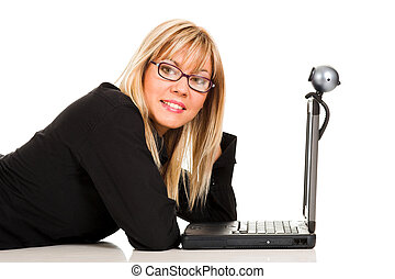 businesswoman using laptop and webcam - A businesswoman...