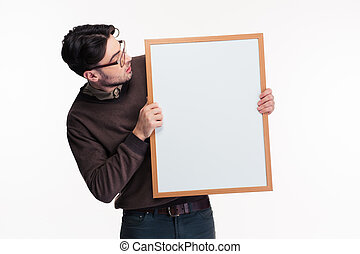 Portrait of a casual man holding blank board