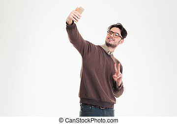 Casual man making selfie photo on smartphone - Portrait of a...