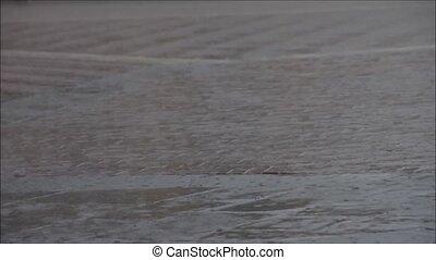 Rain drops falling to cobbles