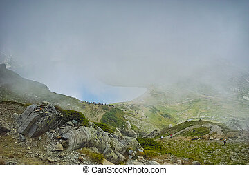 The Seven Rila Lakes, Bulgaria - Fog over The Kidney lake,...