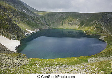 The Seven Rila Lakes, Bulgaria - The Eye lake before storm,...