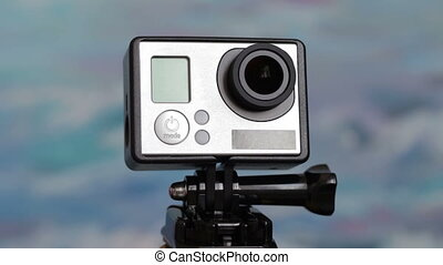 Action camera rotates around its axis The camera in the...