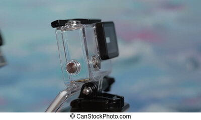 Action camera is inserted into the underwater housing on a...