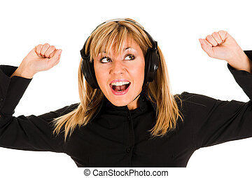 young woman listening music - beautiful smiling young woman...
