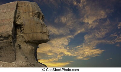 Sphinx head and sunset clouds in Egypt