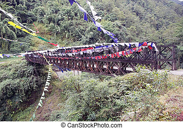 Bridge and prayer flags, Sikkim, India - Bridge with prayer...