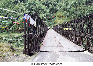 Bridge and prayer flags, Sikkim, India - Bridge with prayer...