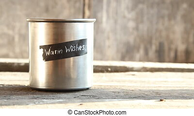 Warm wishes idea - Warm wishes text and cup on a wooden...