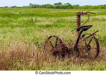 Rusty Old Texas Metal Farm Equipment in Field - Very Old and...