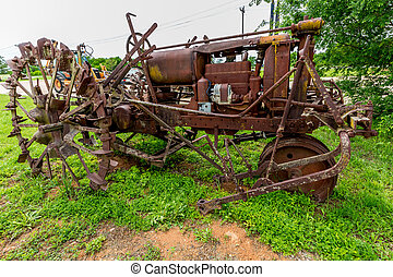 Rusty Old Texas Tractor with Metal Tires Off the Highway in...