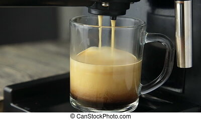 Coffee machine pouring a cup of drink