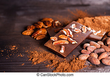 Chocolate products Chocolate, cocoa beans, cocoa and nuts on...