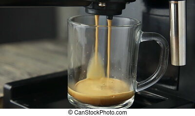 Coffee machine pouring a cup of drink cocktail
