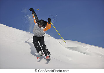 ski freeride - man ski free ride downhill at winter season...