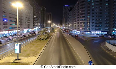 Cityscape of Ajman from bridge at night timelapse. Ajman is the capital of the emirate of Ajman in the United Arab Emirates.