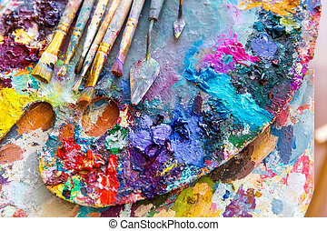 Closeup of art palette with colorful mixed paints and...