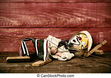 old marionette on a wooden surface, filtered - an old...