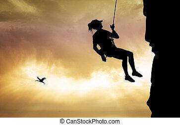 girl climber at sunset