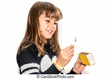 Little girl playing with matches