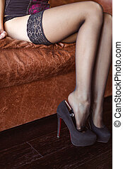 Beautiful slim legs of woman in lace stockings and shoes -...