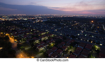 aerial view at dusk of home village in bangkok thailand use for land management and real estate ,residence cummunity