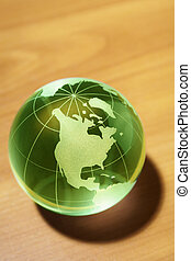 Glass World - green toned globe showing North America and...