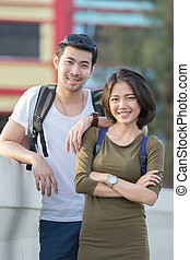 couples of younger asian man and woman relaxing with happy...