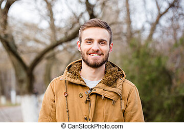 Smiling casual man standing outdoors - Portrait of a smiling...
