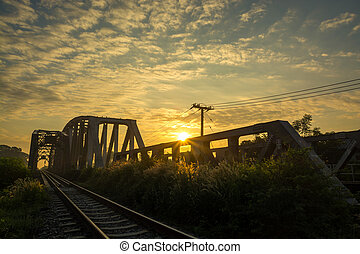Railway bridge at Dawn with Sunrise and nice Cloud