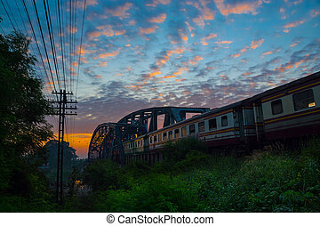 Train Passing by over Rural Railway Bridge in the Morning or...
