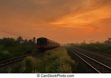 Train Passing by over Rural Railway in the Morning or at Dawn with Sunrise