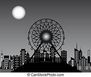 Ferris wheels at night time in the moonlight
