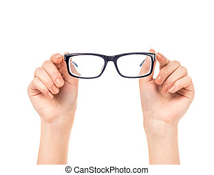 Hands close-up - Female hand holds glasses isolated on a...