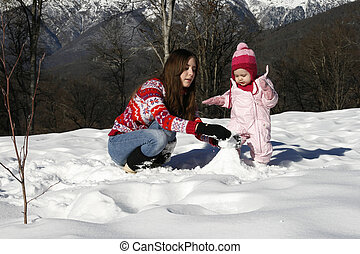 Mother and daughter in winter park
