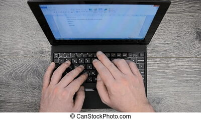 Man working on a notebook using touchscreen, with cozy...