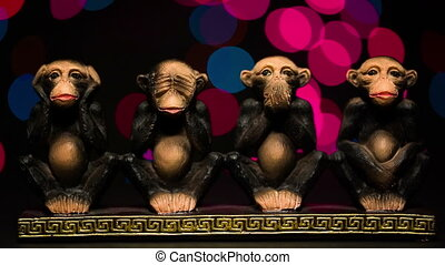 Figure four symbolic monkeys on bokeh background. Close up...