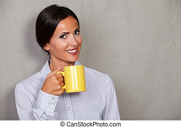 Happy young lady holding hot drink - Happy young lady...