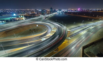 Cityscape of Ajman from rooftop at night timelapse. Ajman is the capital of the emirate of Ajman in the United Arab Emirates.