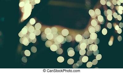 White bokeh lights moving. - White bokeh lights moving close...